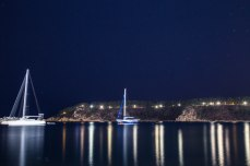 Night shot of sailboats with Daewangam Park in the background. Long exposure shot from Ilsan Beach in Donggu Ulsan.