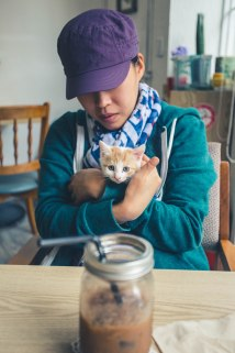 Abby hanging with one of the kittens at Freedom Station Cafe in Donggu.