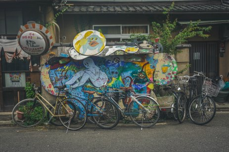 Bicycles and street art somewhere in Kyoto.
