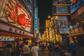 Walking through the night market at Dotonburi in Osaka.